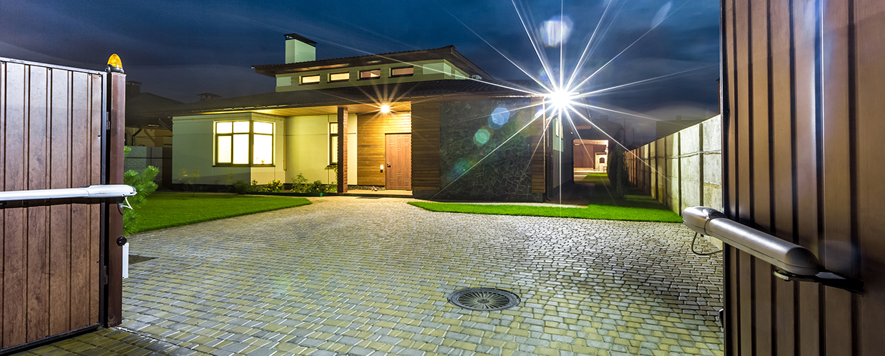 Detached luxury house at night - view from outside.